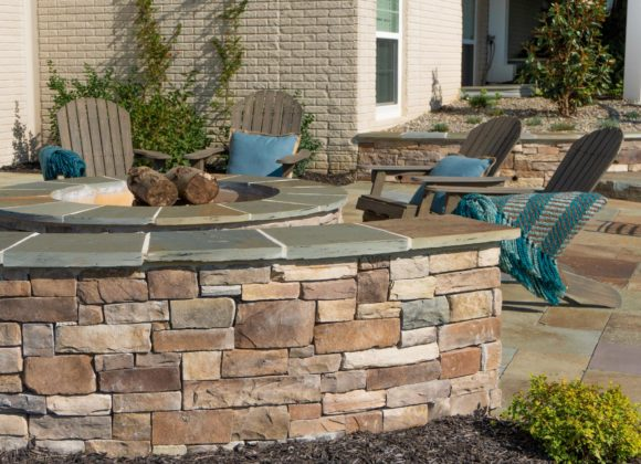 Retaining wall for patio and fire pit outdoor sitting area